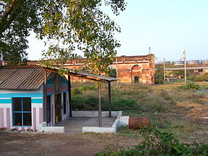 Royapuram railway station - A small temple at the station, with the heritage buildings at the background