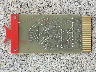 Printed circuit board - A board designed in 1967; the sweeping curves in the traces are evidence of freehand design using adhesive tape