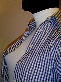 Sous-pull blanc à col roulé porté sous un chemisier f34489f757c