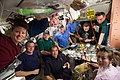 STS-131 and Expedition 23 crew members share a meal.jpg