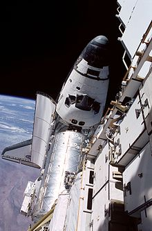 Atlantis docked to the Destiny laboratory on the ISS, taken from atop the P6 truss during an EVA