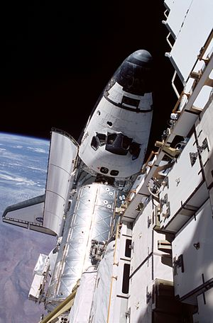 STS-104 - Atlantis docked to the Destiny laboratory on the ISS, taken from atop the P6 truss during an EVA