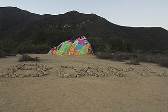 Stephen Duneier - Photo of the 2013 yarnbomb installation by Stephen Duneier atop Saddlerock in the mountains above Montecito California.