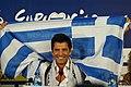 Sakis Rouvas Raising Greek Flag.jpg