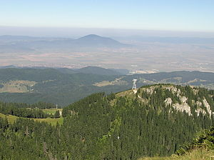 Burzenland - View of part of the Burzenland from the peak of Postăvaru. Ghimbav is on the right, while Codlea can be seen in the distance on Măgura Codlei.