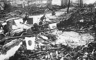 Japanese Imperial Army soldiers during the Battle of Shanghai, 1937 Shanghai1937IJA ruins.jpg