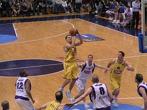 EuroLeague Basketball Legend Award - Šarūnas Jasikevičius, in yellow, with the ball, as a Maccabi player, 2003.