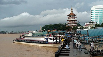 Sibu is a town built on the banks of the mighty Rajang River. Seen here is the wharf and in the background is the historical Tua Pek Kong Temple.