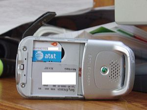 English: An AT&T Mobility mini SIM Card in a S...
