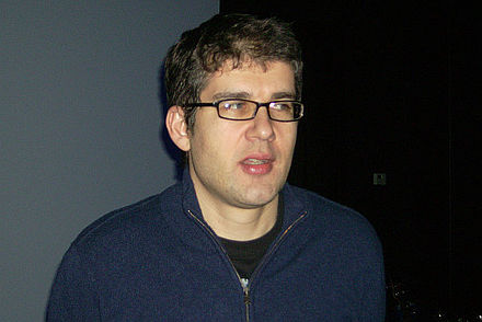"In the 1990s, longtime contributor Simon Reynolds (pictured in 2011) coined the genre ""post-rock"" and wrote influential essays on a variety of developments in rave that he termed the ""hardcore continuum"". Simon Reynolds.jpg"