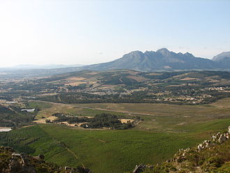 Somerset West - Somerset West from Sir Lowry's Pass. The mountain in the picture is Helderberg. In this view most of Somerset West urban area is hidden by the hill Schapenberg.