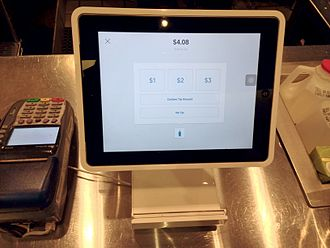 Square, Inc. - Square Stand at a coffee shop turned around for the customer to choose a tipping option