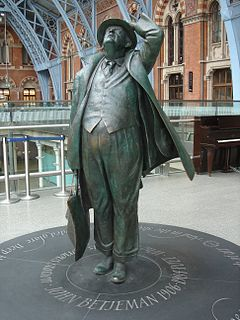 Statue of John Betjeman statue in St Pancras railway station, London