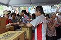 Staff Sending Bottled Water to Neighbors after Ghost Festival 20150822.jpg
