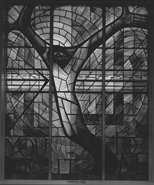 "16th Street Baptist Church - Stained glass window donated by the people of Wales after the 1963 bombing of the church. The south-facing window was designed by Welsh artist John Petts and depicts a black Jesus with his arms outstretched. The right hand symbolizes oppression, his left is asking for forgiveness. The words ""You do it to me"" refer to the biblical parable of the sheep and the goats."