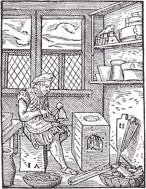 Punchcutting - 16th century engraving depicting a punchcutter.