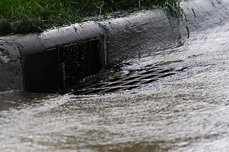 Urban runoff - Urban runoff flowing into a storm drain