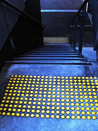 Somatosensory system - Touch is a crucial means of receiving information. This photo shows tactile markings identifying stairs for visually impaired people.