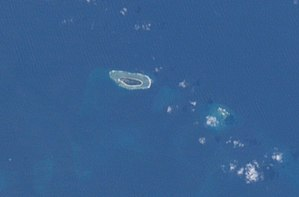Zhongzhou Reef - International Space Station photograph of Taiping Island (left) and Zhongzhou Reef (right)