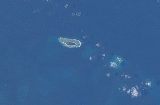 Taiping Island - International Space Station photograph of Taiping Island (left) and Zhongzhou Reef (right)