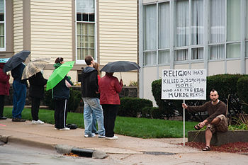 "The sign reads: ""Religion has killed 2,22..."