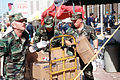Tech. Sgt. Ken Walker (left), Tech. Sgt. J. D. Sagor (center) and Staff Sgt. Michael Hagood from Tinker Air Force Base, Oklahoma, work to pass out bottles of water to rescue and support personnel at DF-ST-96-00585.jpg