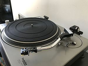 Technics SL-1200 - The Technics EPA-120 tonearm was standard equipment on the original SL-1200 and was significantly different than the tonearm introduced with the MK2 and subsequent models