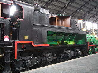 Tender (rail) - Cutaway cross section showing a Spanish tender designed for fuel oil. Green areas hold water and brown areas hold fuel oil. There is a special arrangement to prevent sloshing around during the movement of the train.