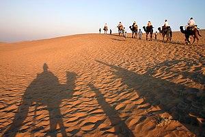 Outline of Rajasthan - Camel ride in the Thar desert near Jaisalmer.