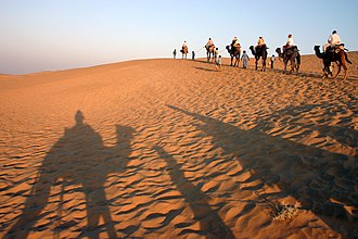 Outline of Rajasthan - Camel ride in the Thar desert near Jaisalmer.