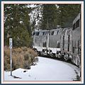 The California Zephyr passes bye the old state bridge at East Bond Colorado - panoramio.jpg