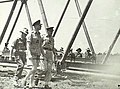 The Duke of Gloucester, Governor-General of Australia (2); Brigadier R.J.H. Risson (3); and Major R. Drummond (1), examine a 'Steele' bridge, Queensland, 1945.JPG