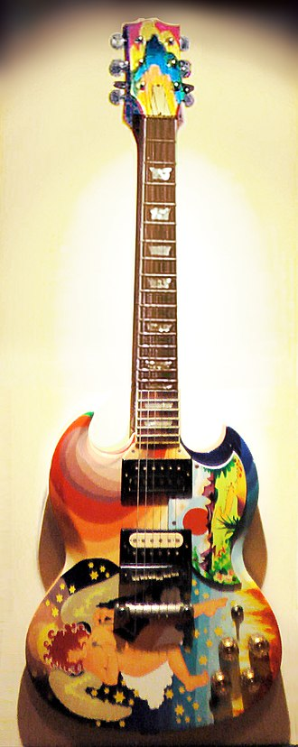 "Eric Clapton - Clapton's The Fool guitar (replica shown), with its bright artwork and famous ""woman tone"", was symbolic of the 1960s psychedelic rock era."