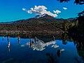 The Llaima volcano is reflected on the Rainbow Lagoon.jpg