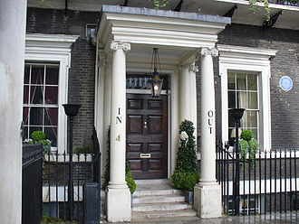 "Naval and Military Club - Entrance of the Naval and Military Club in St James's Square, with ""IN"" and ""OUT"" in humorous reference to previous Cambridge House premises"