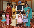 The Prime Minister, Dr. Manmohan Singh and his wife, Smt. Gursharan Kaur with the young children who tied Rakhi to him during the occasion of 'Raksha Bandhan', in New Delhi on August 05, 2009.jpg