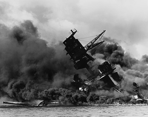 USS Arizona burned for two days after being hit by a Japanese bomb. Parts of the ship were salvaged, but the wreck remains at the bottom of Pearl Harbor to this day and is a major memorial. The USS Arizona (BB-39) burning after the Japanese attack on Pearl Harbor - NARA 195617 - Edit.jpg