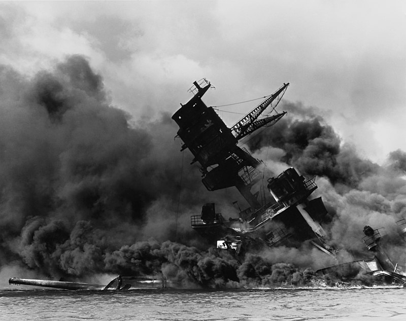 The USS Arizona warship dying in smoke during the attack of Pearl Harbor on Dec. 7, 1941. This attack by Japan provoked the United States into joining World War II.