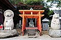 The Yashima tasaburo tanuki (left) is one of the three famous tanuki of Japan, who guided Kobo Daishi (the founder of Shingon buddhism) to the top of Yashima among other good deeds. (6480378621).jpg