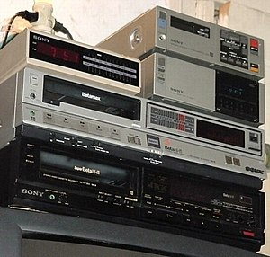 "Betamax - Three Sony Betamax VCRs built for the American market. Top to bottom: SL-2000 portable with TT-2000 tuner/timer ""Base Station"" (1982); SL-HF 300 Betamax HiFi unit (1984); SL-HF 360 SuperBeta HiFi unit (1988)."