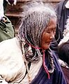 Tibetan elderly woman in prayer detail from Elderly Pilgrim, Tsurphu 1993 (cropped).JPG