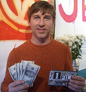 Todd Oldham - Oldham holding five $20 bills and a producer credit for The 1 Second Film in January 2005