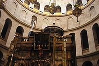 The Edicule of the Church of the Holy Sepulchre, believed to be the site of Calvary and the Empty Tomb of Christ, with the dome of the rotunda visible above.