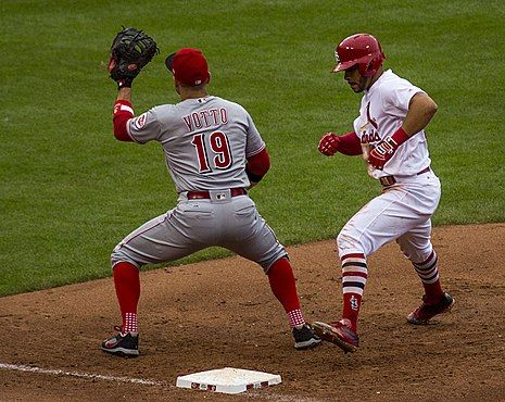 Pham safe on the pickoff throw as Cincinnati Reds first baseman Joey Votto covers Tommy Pham safe.jpg