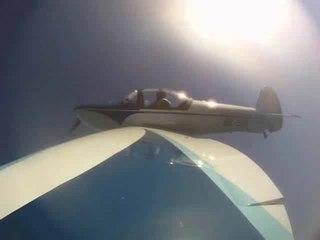 Barrel roll aerial maneuver