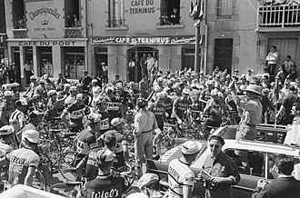 1962 Tour de France - The peloton of the 1962 Tour prior to the start of the race in Nancy, led by the Tour's race director Jacques Goddet