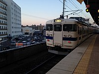 Train bounding for Kamegawa Station leaving from Beppu Station at dusk.JPG
