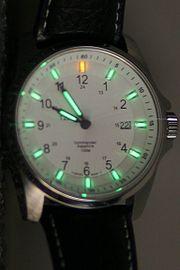 A tritium illuminated watch face