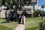 President Donald J. Trump walks with Rev. James R. Harlan, rector of the Church of Bethesda-by-the-Sea, following Easter church service, Sunday, April 1, 2018, in Palm Beach, Florida.