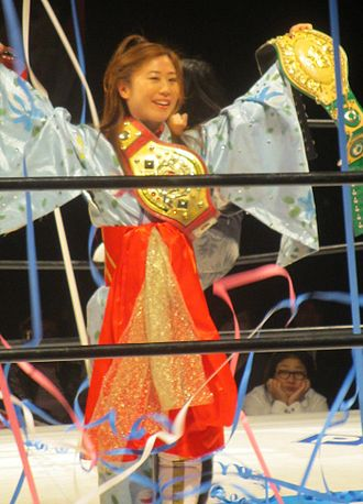 International Ribbon Tag Team Championship - Tsukasa Fujimoto, former six-time champion, with the International Ribbon Tag Team Championship belt wrapped across her chest